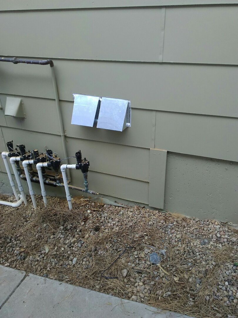 Broomfield, CO - Install new combustion air hoods on outside of house