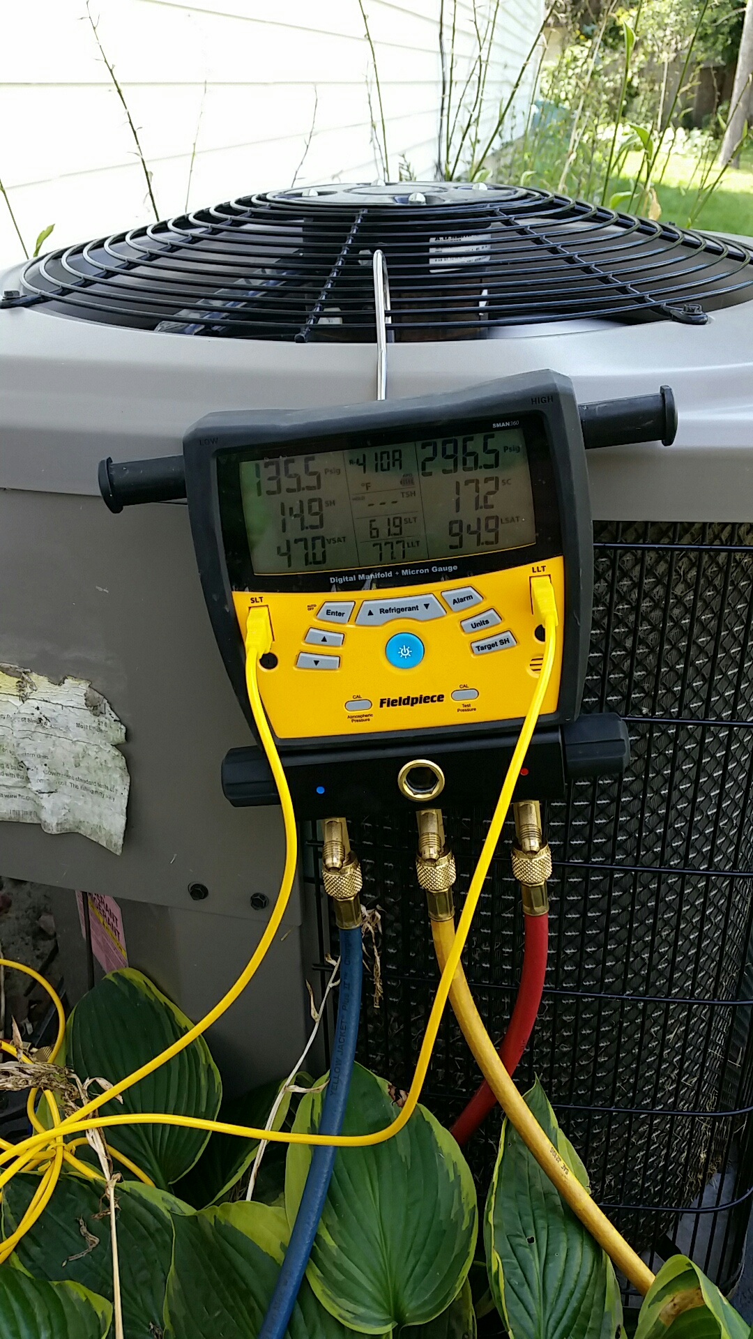 Clinton, WI - A/C unit was frosting/icing up due to being low on Refridgerant.  Tightened Piston nut and added proper charge.