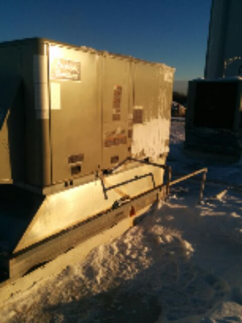 Palatine, IL - Fixing a furnace up on a roof enjoying this lovely Chicago weather