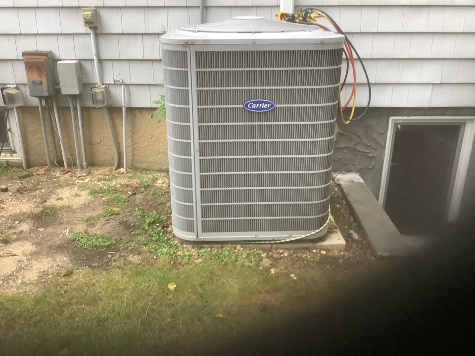 Replaced capacitor on one Carrier condenser in Dix Hills