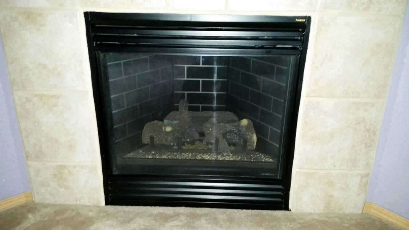Fountain, CO - Gas fireplace maintenance service call. Performed tune up,  clean and safety check on Heatilator fireplace.