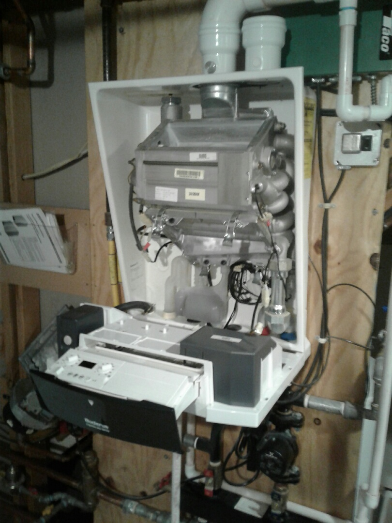 Lake Villa, IL - Performing Service and maintenance on buderus boiler with indirect fired water heater