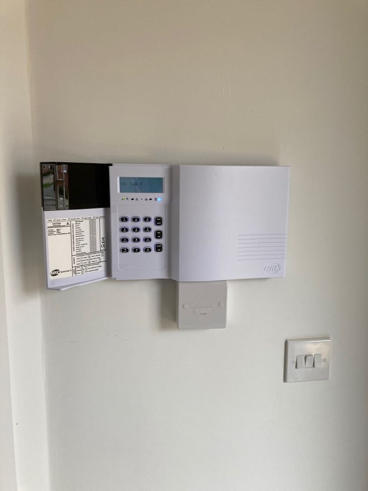 Installing a HKC wireless home alarm system on a Bovis site near Wellingborough, Northamptonshire.