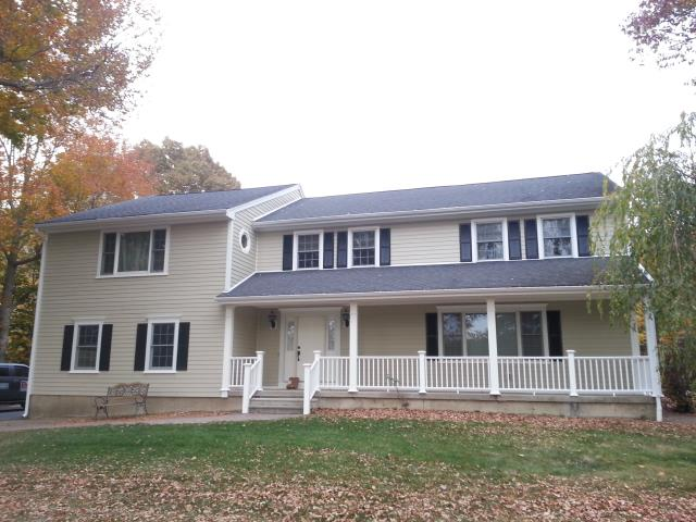 """Stratford, CT - Our expert crew installed 4"""" exposure James Hardie siding in Sandstone Beige, paired with Arctic White HardieTrim."""
