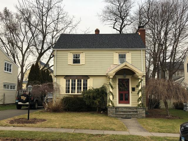 """Stratford, CT - These Stratford homeowners called Burr Roofing, Siding, & Windows when they noticed a leak. Water was running behind the roofing shingles, causing interior paint to start """"bubbling""""; a clear sign that something was wrong. When we arrived on site, it was obvious that this issue needed addressing. Our expert team replaced the failing shingles with Northgate CertainTeed shingles in Moire Black. In addition, we re-pointed the chimney and replaced the existing flashing with 16oz copper."""