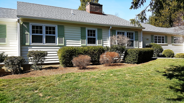 """New Canaan, CT - These homeowners decided to install 5"""" James Hardie clapboard in Sail Cloth, paired with Arctic White HardieTrim, and Wood Ultrex All White Windows by Integrity from Marvin Windows and Doors. This remodel turned out beautifully and gave the homeowners a fresh and clean look for their home. If your home needs an update, call for an estimate today!"""