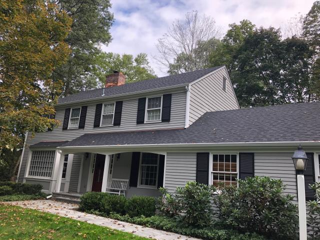 New Canaan, CT - This New Canaan roof was tired and needed a replacement. Mrs. B called the experts at Burr Roofing, Siding, & Windows to discuss her options moving forward. We performed an inspection of the roof system and it was clear a full replacement was the only option. Our crew got to work installing CertainTeed Landmark A/R shingles in Charcoal Black. Now, this home is protected for years to come!