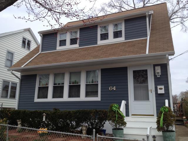 """Stratford, CT - This homeowner was looking for a siding upgrade that would be true to the home's original look. After visiting the property for an estimate, we suggested installing 5"""" James Hardie Smooth Evening Blue HardiePlank. This fiber cement siding provided the homeowner with the same look and a better protected home."""