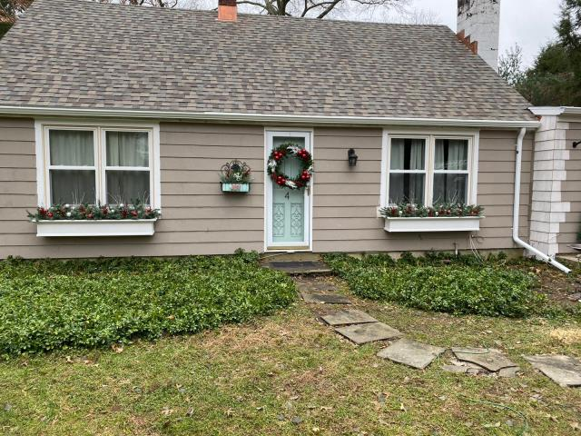 Westport, CT - Our expert team installed ice and water underlayment on this entire roof, followed by CertainTeed's Landmark Pro shingles in Weathered Wood. Our team was in and out in a matter of two days! The homeowner was so thankful for the quality of service, she called us back to install windows!