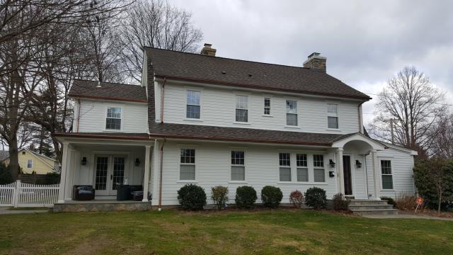 New Canaan, CT - This exterior remodel includes a small addition, adding indoor and outdoor living space. After the structure was complete, the Burr team removed the existing siding and installed new James Hardie fiber cement. The homeowners wanted a clean, craftsman aesthetic, making Arctic White Hardie the perfect choice for their new exterior. We accented the addition with Arctic White Board & Batten, upgrading the trim to Artisan. Lastly, we added historic sills and crowns to the windows for a special touch of detail. This home is drop dead gorgeous!