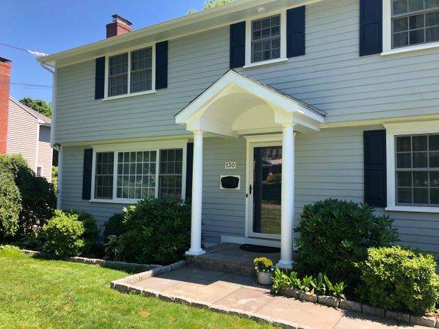 "New Canaan, CT - Our crew got to work installing James Hardie clapboard in Light Mist with a 5"" exposure and cedarmill finish. Underneath the Hardie is Henry Blueskin VP100 self-adhesive house wrap, creating an energy efficient barrier between indoors and outdoors. In addition to brand new siding, we also replaced 16 windows with all white Marvin Integrity Wood-Ultrex windows and installed Therma Tru primed smooth star entry doors. Lastly, our skilled carpentry crew built a custom portico, welcoming friends and family into the home."