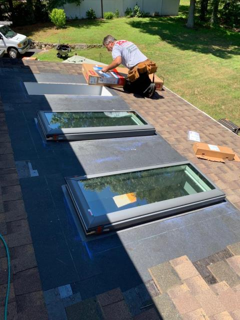 Easton, CT - This homeowner realized something was wrong with his skylights after a large rainstorm. There was obvious leaking, due to the lack of flashing and proper underlayment. The Burr team remedied the problem, replacing the existing skylights with VELUX solar venting skylights. Nick, our roofer, installed the proper ice and water barrier, and flashing. Now this home is watertight!