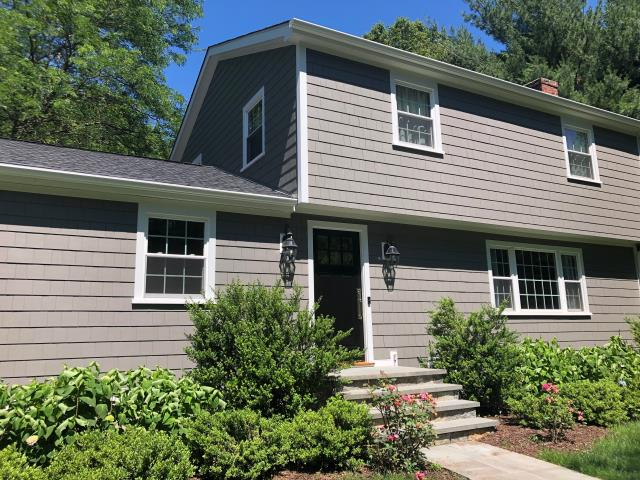 New Canaan, CT - These homeowners could not be happier with their brand new home! After spending the summer remodeling their interior, the couple welcomed our team in January to complete the exterior portion of the project. By the time we left their home was unrecognizable! We replaced the old cedar siding with James Hardie individual shingles in Aged Pewter. We also tore off the failing roof and replaced it with ice & water underlayment and CertainTeed Landmark AR shingles in Moire Black. While doing so, we also added fly rafters and eaves, giving the home more depth and strong shadow lines. Talk about a Life Improving Home Improvement!
