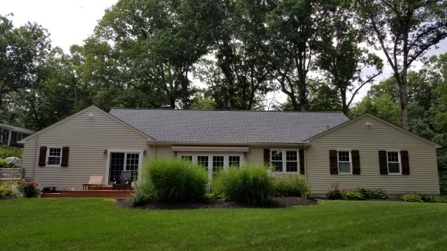 """Stamford, CT - We quickly got to work installing 5"""" exposure clapboard in Sandstone Beige, paired with Sail Cloth trim and woven corners. We also replaced all existing soffits, fascias and trim with PVC, making this entire exterior low maintenance and beautiful!"""