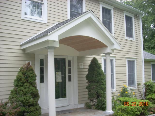"""Stamford, CT - This Stamford home needed a whole new exterior to protect the family from exterior elements. The Burr team presented the homeowners with their options according to their desired aesthetic and budget needs. Ultimately, they chose to install new James Hardie clapboard siding in Sandstone Beige with a 5"""" exposure and cedarmill finish. We also replaced the existing roof with CertainTeed Landmark Pro shingles. We upgraded the architecture of the home by adding faux gables and a doghouse dormer to the second story. Lastly, we built a custom portico, creating a welcoming entryway for friends and family."""