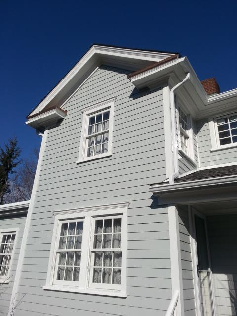 "New Canaan, CT - Although the homeowners chose to stick with the original color scheme, updating their home added value and curb appeal. Their design included 4"" James Hardie clapboard in Light Mist, Arctic White HardieTrim, new Lincoln casement windows, and HardieTrim casings on all windows and doors."