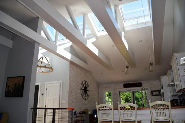 Darien, CT - Did you know VELUX solar venting skylights can save you up to 30% on your Federal Tax Credit? This Darien homeowner added multiple skylights to his cape, creating an open and airy space to spend time with friends and family. These solar powered skylights are both beautiful and a great investment!