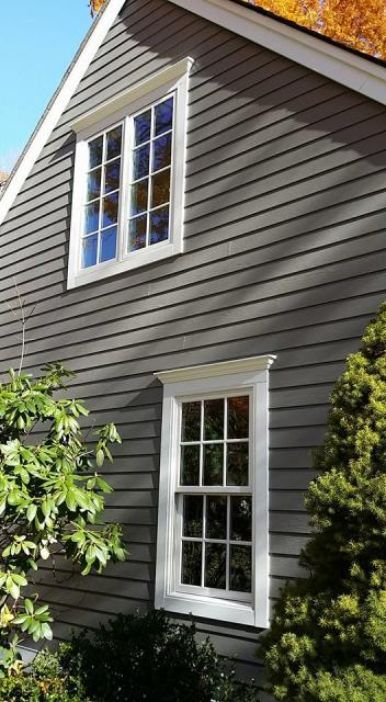 """Fairfield, CT - This remodel in Fairfield, CT features Marvin Integrity Wood Ultrex windows and 5"""" Cedarmill Aged Pewter James HardiePlank siding. The customer couldn't be happier with how good the home looks!"""