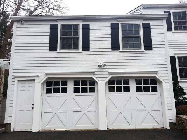"Westport, CT - This homeowner chose to stay true to the home's original appearance by installing 5"" Cedarmill Arctic White James Hardie clapboard, Arctic White HardieTrim, and HardieTrim window casings on all doors and windows."