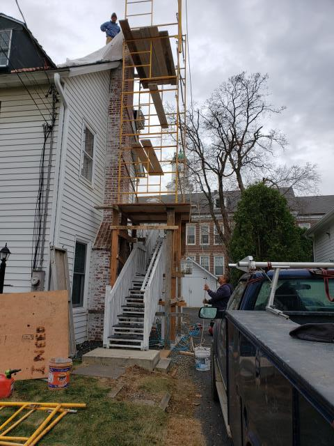 Stratford, CT - Chimney rebuild in Stratford, CT. The homeowners were experiencing major leaking around the chimney. Thankfully, the Burr team is here to help!