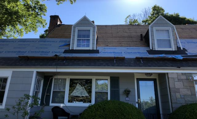 Stamford, CT - In progress roof replacement in Stamford, CT! This home is getting all new CertainTeed Landmark AR shingles in Driftwood. The homeowner is so excited for the peace of mind the CertainTeed warranty brings.
