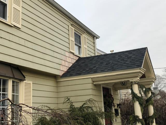 Stratford, CT - Our crew completed this roof replacement in Stratford, CT using CertainTeed Northgate shingles in Moire Black. Painting the replacement siding shingles is next!