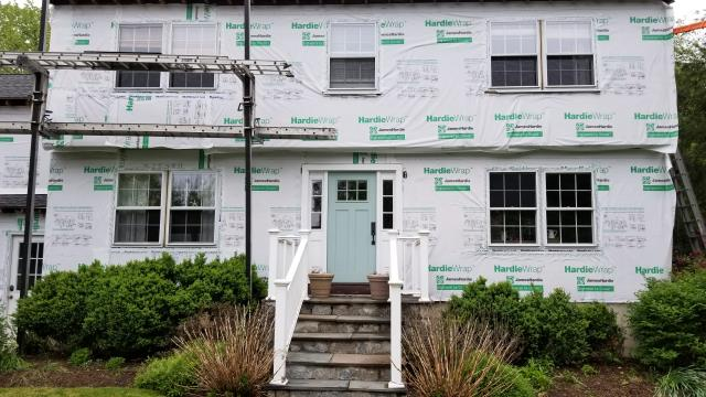 Darien, CT - HardieWrap installation in Darien is complete! The crew is setting up to start the James Hardie siding install. The homeowners settled on Individual Shingle in Cobble Stone.