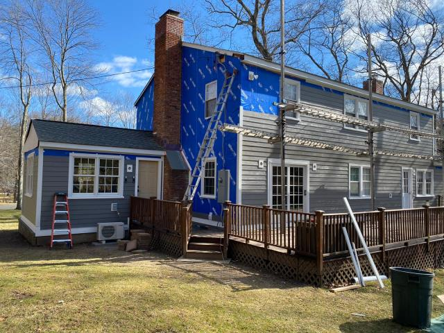 Stamford, CT - Siding foreman David and his crew are working hard installing James Hardie fiber cement clapboard in Stamford. This homeowner chose the color Aged Pewter, found in Hardie's Statement Collection. Next, our carpentry crew will come to build a custom portico over the front entryway.