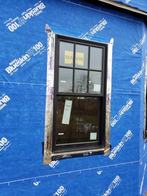 Madison, CT - Window installation is both a science and an art. John and Brian, Burr's carpenters, are always sure to install Marvin windows according to best practices. Beautiful flashing job guys! These homeowners can't wait to see waterfront views through their brand new windows!