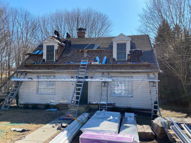 Bethlehem, CT - The crew is installing CertainTeed's Landmark Pro shingles in Resawn Shake. The next step is siding replacement! Our Hardie crew will be here shortly to start removing the old vinyl siding, replacing it with James HArdie fiber cement clapboard in Evening Blue.