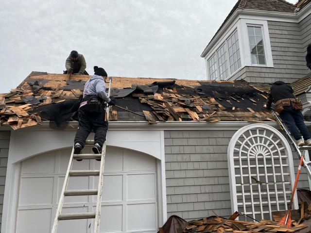 """Norwalk, CT - The crew is out in Norwalk today starting tear off this cedar roof. We will be replacing the cedar shingles with brand new 18"""" Blue Label Perfection shingles. If your cedar roof needs some TLC, call Burr Roofing, Siding, & Windows to discuss your options!"""