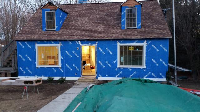 Bethlehem, CT - Great day of tear off and wrap in Bethlehem, CT. David and his crew are using Henry Blueskin VP100 self adhesive house wrap to keep this home water tight until James Hardie siding installation begins.