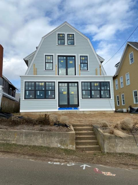 Madison, CT - We're almost at the finish line in Madison, CT! This waterfront home was remodeled using James Hardie fiber cement clapboard, and Marvin windows and doors. Prior to siding installation, the Burr team used Henry Blueskin VP100 house wrap to make sure the entire home is water tight for years to come.