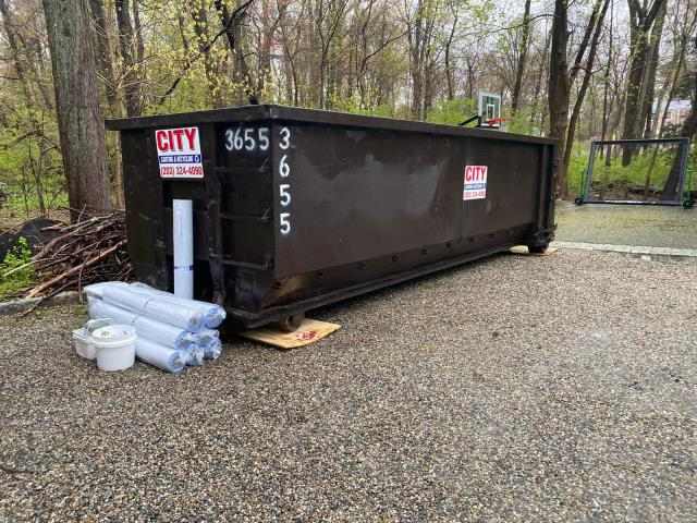 Greenwich, CT - Dumpster and materials are ready to go in Darien, CT. We always place dumpsters on plywood to protect your driveway!