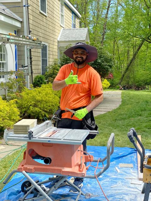 Greenwich, CT - Victor is hard at work in Darien installing James Hardie Primed Individual Shingle. Check out his cut station. We make sure to tarp under any cut stations, keeping the dust collected in one area.