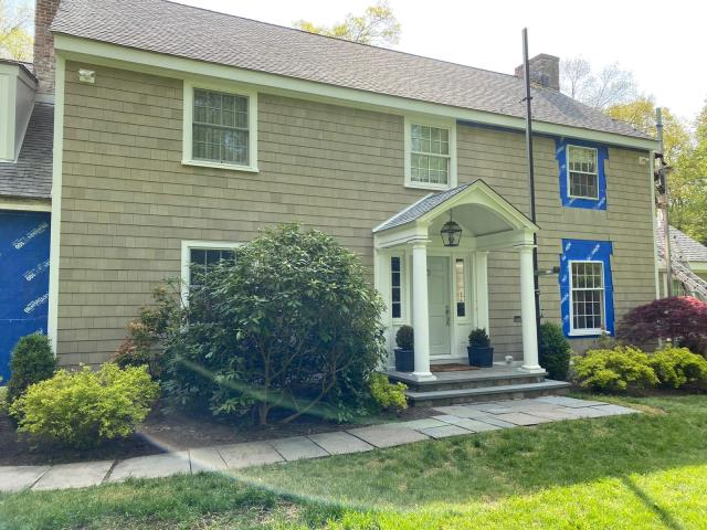Greenwich, CT - What an improvement! The crew is installing James Hardie Primed Individual Shingle in Darien to give this beautiful home the curb appeal it deserves.