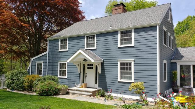 Stamford, CT - Final product in Stamford, CT! Burr's team of professional installers transformed this home with James Hardie clapboard in Evening Blue. The carpentry team also built a beautiful custom portico with structural korbels, and replaced 20 windows with Marvin products found in the Essential line.
