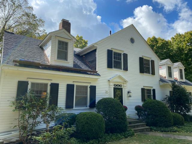 Darien, CT - Almost wrapped up in Darien, CT! Sermon and the crew installed a beautiful CertainTeed architectural shingle roof, bringing this exterior back to life. Up next, the homeowner plans to paint the entire home for a refreshed finished product.