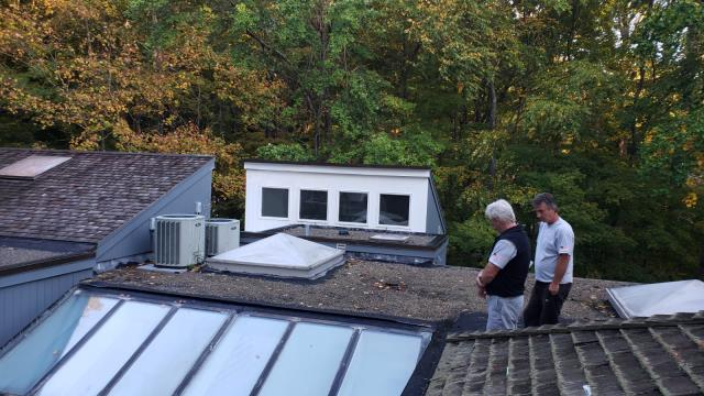 Weston, CT - Chris and Nick are in Weston taking a closer look at this roof. The roof is a combination of shingles paired with flat roofing and a lot of old-school gravel. We are looking forward to completely replacing the existing roof and ridding this home of the algae and mildew.