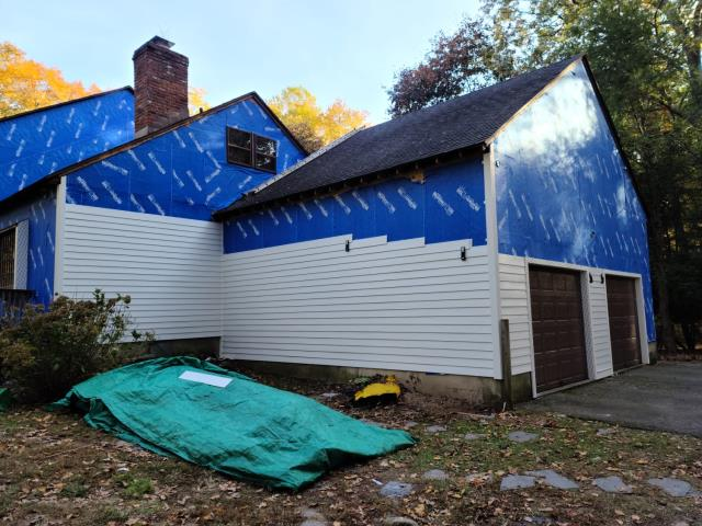 Easton, CT - Mid James Hardie install in Easton, CT. These homeowners are so excited to have a low-maintenance, pest resistant exterior after years of dealing with woodpeckers and other critters eating away at the pre-existing wood siding.
