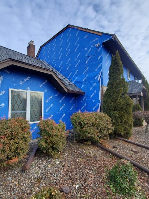 Windsor, CT - In progress siding replacement in Windsor, CT. We removed the existing siding to inspect the home's sheathing before installing Henry Blueskin VP 100 house wrap to protect the exterior until its time for James Hardie fiber cement siding.