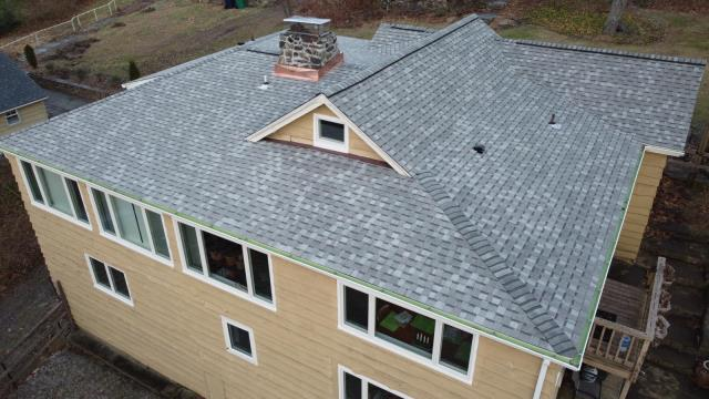 New Fairfield, CT - Roof replacement complete in New Fairfield, CT. This project features Landmark Pro shingles in Cobblestone Gray.