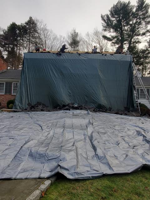 Westport, CT - Property protection is always key. During roof replacement we use tarps to protect your home and surrounding landscaping. This ensures a beautiful final product with no scraps left behind.