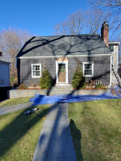 Stamford, CT - Step one of siding replacement in Stamford - remove all existing siding and inspect sheathing to prepare for James Hardie fiber cement clapboard in Deep Ocean.