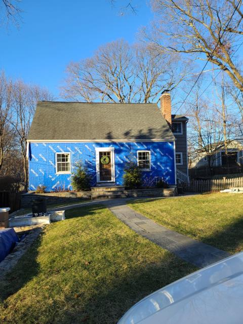 Stamford, CT - Henry Blueskin VP100 self adhesive house wrap is protecting this exterior until it's time for James Hardie clapboard siding in Deep Ocean. This homeowner is so excited for the transformation!