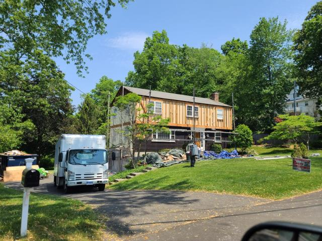 New Canaan, CT - At this New Cannan home, we are installing a new roof by CertainTeed, James Hardie Siding in Artic White, and Marvin Brand windows.