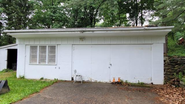 Trumbull, CT - This poor garage got hit by a tree recently and needs a new roof courtesy of Burr. We will also be adding swinging garage doors to bring this workshop new life.