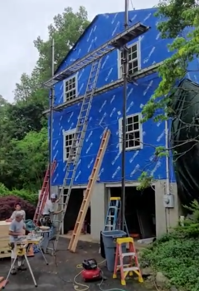 New Canaan, CT - Great progress on this home in New Cannan this morning. Here you can see installation of new high performance Blueskin vp100 from the Henry Company. The Burr team of Certified Marvin Replacement Contractors installing Marvin windows. Coming soon...James Hardie Lap Cedarmill siding in Artic White.