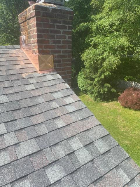 New Canaan, CT - In New Cannan updating a roof with 16oz copper chimney flashings and CertainTeed Landmark Pro Asphalt roof shingles.