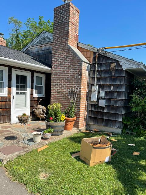 Trumbull, CT - Fixed up the siding alongside the chimney here in Trumbull. We added copper flashings and new cedar siding. You'll also notice the yellow jacket on the electrical wires, necessary to keep our team safe while at work.